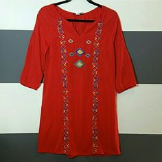 "Vibrant Red Aztec print tunic dress NWOT Brand new, tag attached  Gorgeous vibrant red tunic dress with Aztec threaded print on the front. Pair this dress with fringed booties or strappy heels and a head piece!   Size medium (only 1 available) Length approx 33"" Sleeve with elastic at the ends Multi color print 100%polyester Dresses"