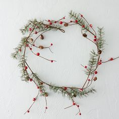 """A dusting of snow tops this mixed garland of cheerful berries and pine boughs.- Foam, plastic, pinecone, cotton, paper, wire- Indoor use only- Imported5""""W, 46""""L"""