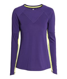 Purple long-sleeved running top in breathable & functional fabric with cuff thumbholes, neon yellow accents, and reflective details. | H&M Sport