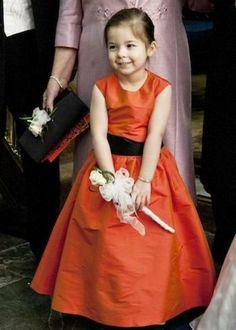 Flowergirl in long orange Dessy dress