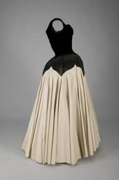 If James were not so clever, the Petal's twenty-five yards of material would have created an undesirable bulk at the waist. He solved this by stitching most of the material to petal shaped hip panels and only one layer into the waist seam. The skirt's tremendous weight has caused extensive damage to the interior construction. Nearly 120 hours of conservation were necessary to stabilize it for display.