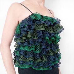 I tried this ruffle yarn and it is quite easy aslong as you watch the videos and always skip a stich this website has approximately 16 patterns in both knit and crochet ;)