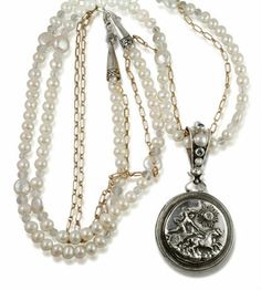 A double delight.  Thick long pearl chain and antique inspired pictures of horses with angels and chariots.  Caracol - Inspired Jewelry and Handbags - Mars and Valentine Two Sided Chariot   Angel   Galloping Stallion Pendant   Necklace, $640.00 (http://www.caracolsilver.com/mars-and-valentine-two-sided-chariot-angel-galloping-stallion-pendant-necklace/)