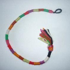 Atébas amovible en laine / multicolore 25 cm