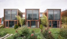 residences in three containers arranged side by side