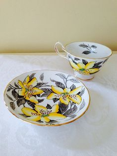 Royal chelsea english bone china tea cup and saucer, yellow lily china cup and…