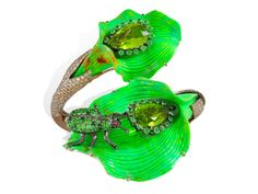 Amazonia collection ~ Bracelet in black rhodium gold with brown and white diamonds, green turquoises, green garnets, peridots and rubies ~ An explosion of surprising green colours transports us to Amazonian forest filled with tropical birds, exotic insects and indigenous plants