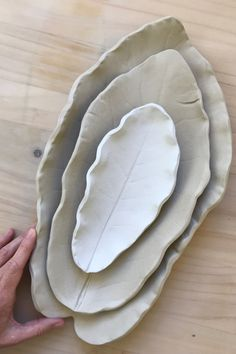 More Puka leaves in the making. Trying out different sizes and clay bodies. Always learning; These are at the greenware/drying stage of the pottery process, getting ready for the first of two firings.