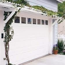 The trellis with ivy gives this garage a lovely cottage feel.