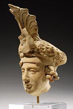 GREEK TERRACOTTA HEAD DATE: 4th Century BC CULTURE: Greek, Hellenistic Greek CATEGORY: Sculpture MEDIUM: Terracotta