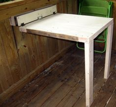 Collapsable Table (Treehouse/Shop) Collapsable Table (Treehouse/Shop): I wanted to build a table for my brother's treehouse that could collapse and not take up space when he wasn't using it. This is what I ended up with. Folding Table Diy, Wall Mounted Folding Table, Fold Down Table, Folding Desk, Folding Walls, Folding Workbench, Collapsable Table, Hinged Table, Murphy Table