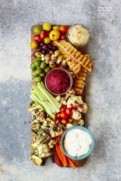 Few things are more low-maintenance than a tapas board, a selection of light snacks or appetizers arranged on a platter. But it's not as simple as just throwing a bunch of stuff on a piece of wood. Health guru and #fitspo queen Lorna Jane Clarkson shows us the art of assembling the perfect one.