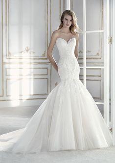 7e81094e3 Este precioso vestido de novia corte sirena con falda baja con volumen