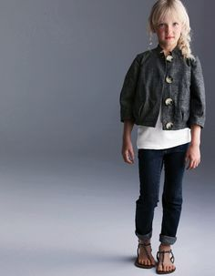 Little girl outfit: skinny jeans, white t, cropped jacket and sandals.
