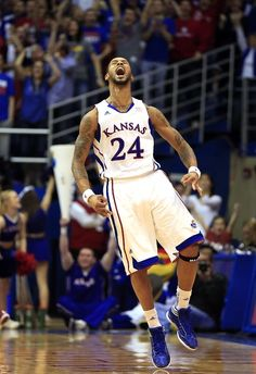 Travis Releford #24 of the Kansas Jayhawks celebrates after sinking a three-pointer late in the game against the Temple Owls at Allen Fieldhouse on January 6, 2013 in Lawrence, Kansas. (Photo by Jamie Squire/Getty Images)