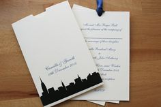 New York Skyline wallet invitation in cream and black with navy ribbon.