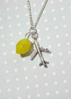 Cabin Pressure necklace with lovely airplane by otterlydesign, $20.00    The lemon is in play!    This is a lovely necklace and perfect for any Cabin Pressure fan or aviation enthusiast! The small plane charm is very detailed and the semi-translucent, dimpled lemon bead adds a lovely splash of colour.