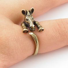 This gold Zebra ring is slightly adjustable with a gentle squeeze. It fits a size 5-9. He is sweet with Swarovski black Crystals eyes and ears as this little guy wraps around your finger, the other end with a curled tail. (Solid Bronze with patina.)  This little guy is stronger than other versi...