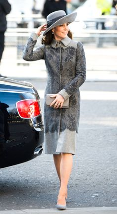 Kate Middleton looked chic in a monochromatic grey look, featuring an Erdem coat with eye-catching lace details, a wide-brimmed hat and velvet pumps as the royals attended the Commonwealth Day service in the year of the Queen's 90th birthday.