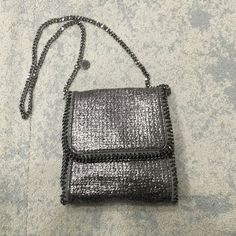 """Stella McCartney Falabella crossbody bag Authentic Metallic grey woven Stella McCartney shoulder bag with gunmetal hardware,Snap closure at front,single slit pocket at interior wall. The bag is in very good condition.No stains at all on outside or inside. The bag was purchased from a creditable online retailer of designer bags and was authenticated. Will come with a dustbag from the online retailer. Item # STL20898. Measurements: shoulder strap 19"""", height is 8.5"""", width is 8"""", depth is 2""""…"""