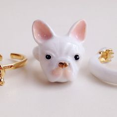 Bangkok artist Mary Lou has designed a set of rings that will fit perfectly on the fingers of any animal lover. Each ring set comes with three separate pieces that fit together to form an adorable creature. One features a squirrel who's chasing a tiny acorn, while others display a variety of animals—a detailed seagull, a white French Bulldog with a golden button nose, a striped zebra, and more—who are each seemingly grasping onto the finger of the wearer. No matter what animal the jewelry…