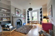 I found this on  Rightmove - love the soft grey walls and the bubblegum pink cupboard