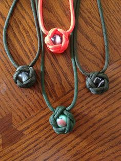 Paracord necklaces... My new craft hobby I picked up at Boy Scout Camp!
