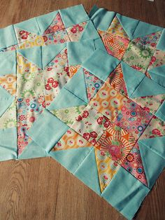 Fun scrap star blocks -- will make an interesting quilt with the blue background -- varigated thread quilting???