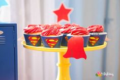 Take a look at the amazing superman cupcakes at this little girls superhero birthday party! See more party ideas and share yours at CatchMyParty.com #catchmyparty #partyideas #superheroparty #girlbirthdayparty #superherocupcakes
