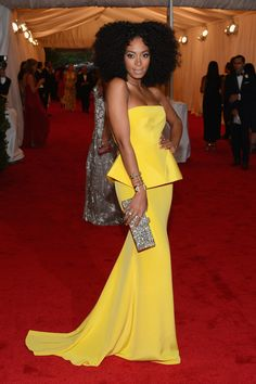 Solange Knowles Strapless Dress - Solange Knowles was a ray of sunshine on the Met Gala red carpet in this gorgeous silk peplum gown.