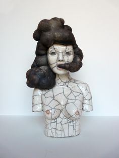 Black smoke // ceramic sculpture  Very limited colour palette and line work on the body of the bust suggests theres a deeper and more serious issue/meaning. The way the black smoke has been portrayed 'as hair' as well as having a more serious issue is clever. The way the facial expressions are shown and how the smoke leads into the mouth also gives us a sense of deeper meaning - pollution and how its affecting us