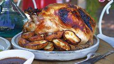 Roast turkey with prune and orange stuffing and Cumberland sauce.