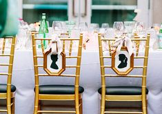 bride and groom silhouette chair signs