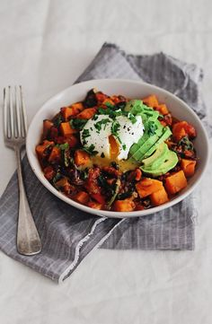 Sweet Potato, carnival squash and black bean stew with avocado and poached egg