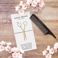 Hairdresser business card template by J32 Design. The design shows a faux gold foil hair scissors, which is split between the front and the back of the business card. Will also work well for hair stylists and beauty salons.