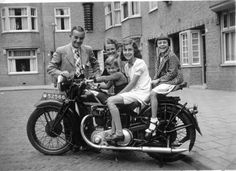 This photo was taken in 1937 in Amsterdam, Holland by Henk Kuipers, father of the 3 children on the motorcycle. From left to right the children are Henk, Tini and Loekie Kuipers. Behind them are Uncle Nico Grijpink and his wife Marieke. Nico is the owner of the British Ariel motorcycle, which they rode from their home in Nijmegen to visit the Kuipers.