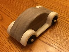I made a VW model for my sons 40th birthday. He drives dubs and has two of them. This replica is about 8 inches long, 4 inches wide and 3 inches high. I make them from hardwood and can do solid maple, oak, hickory, cherry or walnut. Or I can do combos like the one shown with a walnut body and maple fenders. Please indicate your wood preference when ordering. I apply a finish of boiled linseed oil mixed with mineral spirits. Can be used as a toy or keepsake display piece.