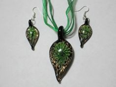 'Glass Flower Pendant Necklace and Earrings' is going up for auction at 12pm Wed, Jul 25 with a starting bid of $6.