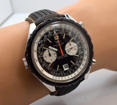 A 1968 Vintage Breitling Navitimer Chrono-matic Ref. DDE.BR.11525/67. This classic chronograph features a patinated, black dial with luminous, Arabic numerals and bar markers, a 17-jewel, caliber 11 automatic movement and a 48mm case. Wow! (Store Inventory # 9880, listed at $4250).  #breitling #black #dial #navitimer #chronomatic #chronograph #automatic #vintagechrono #oversized #mens #vintage #wristwatch #watches #watch #timepieces #classic #watch #stawc