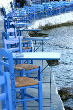 Row of blue tables and chairs at restaurant Karnagio | Limenas, Thassos, Greece