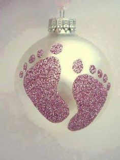 Dip the baby's foot in glue and put it on an ornament. Then sprinkle with glitter! You can do it with a toddler hand too!
