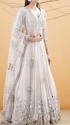 Call/WhatsApp : Unique and thoughtful craftsmanship makes our outfit different and even reserves its value for the future. Indian Fashion Dresses, Indian Gowns Dresses, Indian Bridal Outfits, Indian Bridal Lehenga, Dress Indian Style, Indian Designer Outfits, Designer Bridal Lehenga, Lehenga Indien, Designer Party Wear Dresses