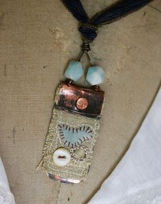 Art Quilt pendant by Rebecca Sower, great source of inspiration - all her stuff is awesome!!