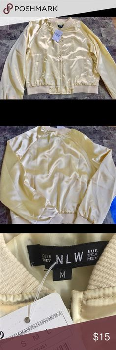 """NLW Golden Bomber Jacket Brand new with tags! Measures 17"""" from top to bottom of zipper! Runs small, fits more a small or extra small! Silk like material! Light golden color 🌼💛 NLW Other"""