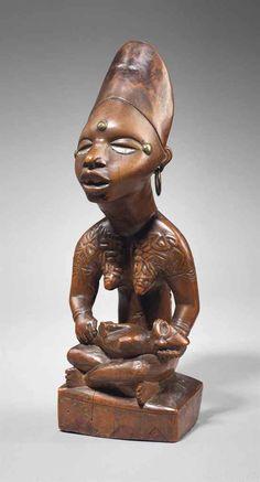 Figure de maternité Yombé, phemba Yombe maternity figure, phemba République Démocratique du Congo  Hauteur: 27 cm. (10¾ in.)