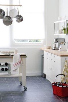awesome use of a kitchen trolley :  A movable island unit  provides extra storage and a handy work surface (look at an Ikea kitchen trolley). also fits neatly beneath a bench top when not in use,