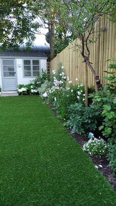 artificial-easy-grass-lawn-summer-house-sandstone-paving-and-white-flower-planting-scheme-6.jpg 900×1,600 pixels
