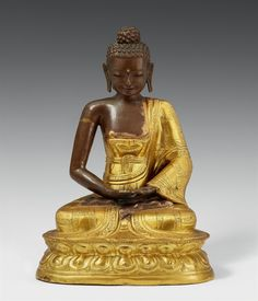 A Tibetan partly gilt copper repoussé figure of Buddha Shakyamuni. 18th/19th century A Tibetan partly gilt copper repoussé figure of Buddha Shakyamuni, seated in vajrasana on a lotus base, with both hands resting on his lap in dhyana mudra, and clad in a monastic robe. Wooden core. Base plate missing. 18th/19th century. Height 35 cm