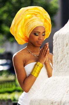 Gorgeous woman and glamorous gele and bracelets. Flawless!