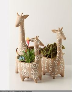 Giraffe pots with cute designs